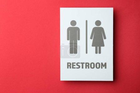 Photo pour Panneau de toilettes unisexe sur fond de couleur. Concept de transgenre - image libre de droit