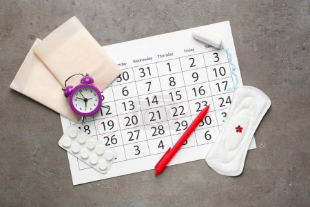 Menstrual calendar with feminine products, pills a...
