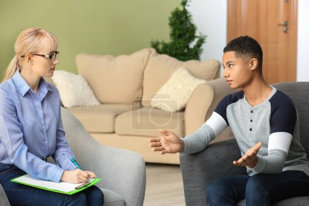Photo for Female psychologist working with teenage boy in office - Royalty Free Image