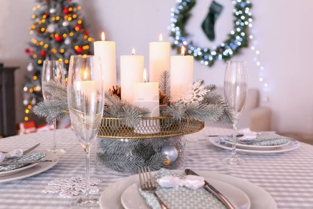 Photo for Beautiful table setting with Christmas decorations in living room - Royalty Free Image