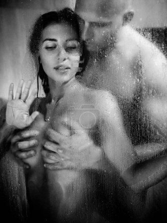 Young beautiful couple makes love in shower