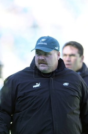 Andy Reid Head Coach of the Philadelphia Eagles on the sidelines during a regular season  NFL game. Andy Reid is an NFL football coach who was the coach of the Philadelphia Eagles before moving on to coach the Kansas City Chiefs