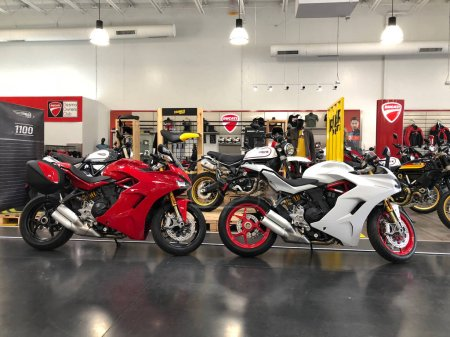 Motorcycles on display at a local dealership in Chandler Arizona with all can of Motorcycle companies. A Motorcycle often a bike is a two or three wheeled motor vehicle.