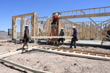 New construction framing being assembled by a crew from the construction company that the workers are employed by. These houses being built in Arizona which is in the Southwest part of the United States.