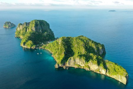 Photo for Aerial drone view of turquoise coastal waters in El Nido archipelago tourist destination of Cauayan Island. El Nido, Palawan, Philippines. - Royalty Free Image