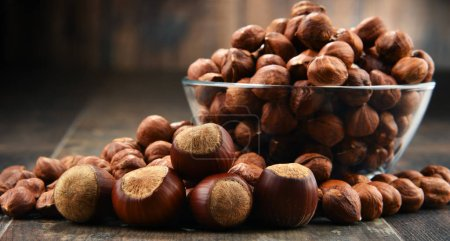 Bowl with hazelnuts on wooden table. Delicacies