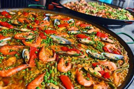 Spanish paella prepared in the street restaurant.