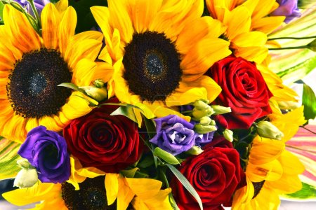Composition with bouquet of flowers including sunflowers and roses