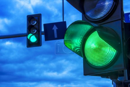 Photo for Traffic lights over urban intersection. - Royalty Free Image