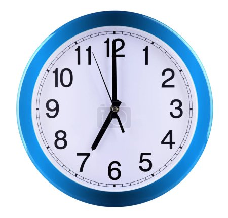Wall clock isolated on white background. Seven oclock.