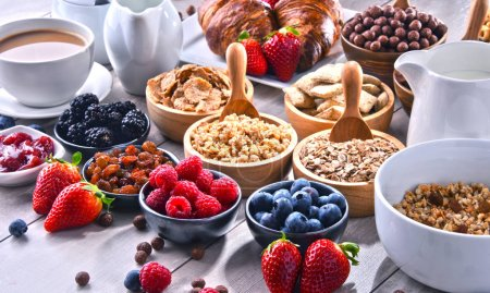 Photo for Composition with different sorts of breakfast cereal products and fresh fruits. - Royalty Free Image