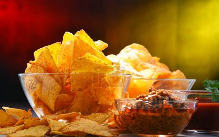 Photo for Composition with glass bowl of potato chips and dipping sauce. - Royalty Free Image