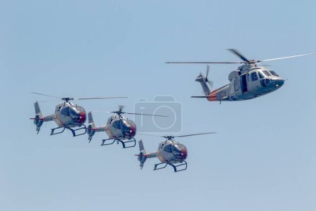 MOTRIL, GRANADA,  SPAIN-JUN 15: Patrulla Aspa, Helicopter Eurocopter EC-120 Colibri and Sikorsky S-76C taking part in an exhibition on the 13th airshow of Motril on June 15, 2018, in Motril, Granada, Spain