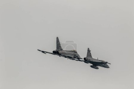 MOTRIL, GRANADA, SPAIN-JUN 10: Aircraft Eurofighter Typhoon C-16 and Saab Jas 39 Grippen taking part in a exhibition on the 12th international  airshow of Motril on June 10, 2017, in Motril, Granada, Spain