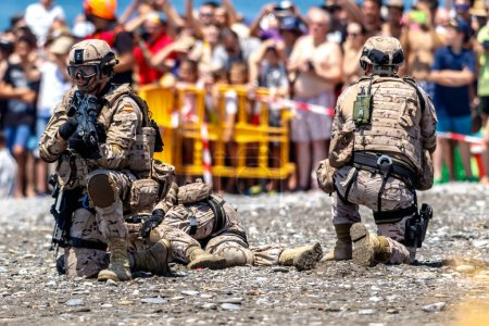 MOTRIL, GRANADA, SPAIN-JUN 11: Spanish Marines taking part in an exhibition on the 12th international airshow of Motril on Jun 11, 2017, in Motril, Granada, Spain