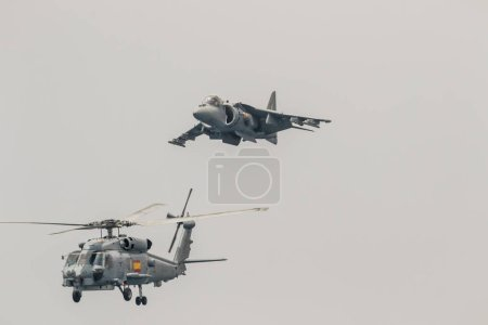 MOTRIL, GRANADA, SPAIN-JUN 09: Aircraft AV-8B Harrier Plus and  helicopter SH-60 Seahawk taking part in an exhibition on the 12th international airshow of Motril on Jun 09, 2017, in Motril, Granada, Spain
