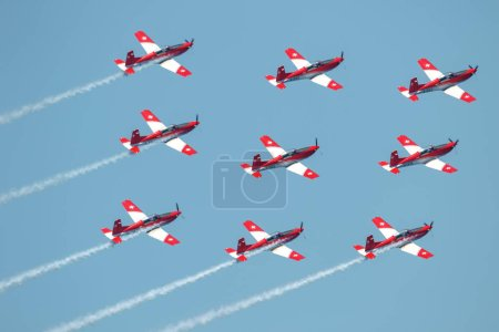 TORRE DEL MAR, MALAGA, SPAIN-JUL 28: Aircraft of the Swiss air force PC-7 Team  taking part in a exhibition on the 3rd airshow of Torre del Mar on July 28, 2018, in Torre del Mar, Malaga, Spain