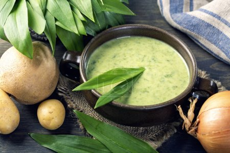 Photo for Ramsons cream soup in a white bowl - Royalty Free Image