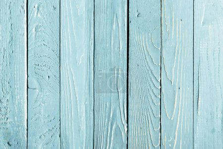 top view of light blue wooden background with vertical planks