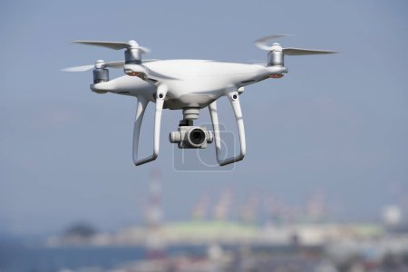Photo for White drone flying over the city, cityscape of Kagawa, Japan - Royalty Free Image
