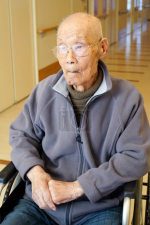 Photo for Senior or elderly man sitting on wheelchair in nursing home - Royalty Free Image
