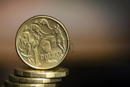 Australian dollar coins over blurred background with copyspace.