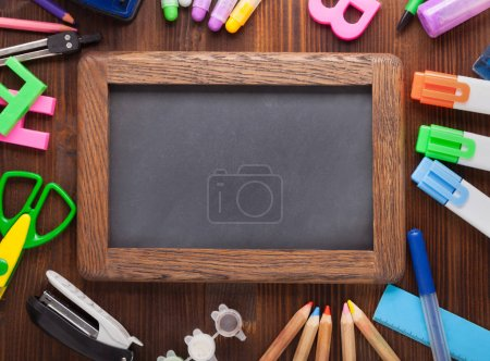 Set of stationery and frame on wooden table