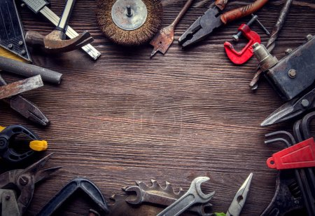 Photo for Top view of grungy old tools on wooden background - Royalty Free Image