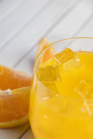 Photo for Cold fresh orange juice and fruits on wooden table. - Royalty Free Image