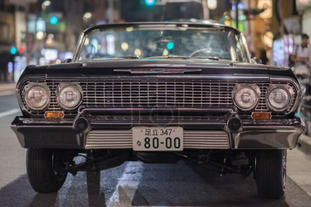 TOKYO, JAPAN - AUGUST 3RD, 2018. Old Chevrolet convertible by the road side in Asakusa at night.