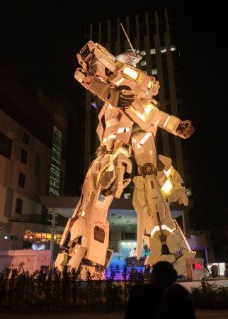 TOKYO, JAPAN - AUGUST 15TH, 2018. Illuminated life sized RX-0 Unicorn Gundam model statue in Odaiba.