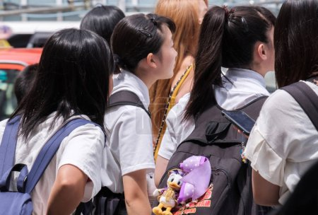TOKYO, JAPAN - AUGUST 19TH, 2018. Japanese school girl in uniform walking in Shibuya street.