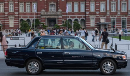 Photo for TOKYO, JAPAN - SEPTEMBER 8TH, 2018. Taxi near the tokyo Railway Station plaza building - Royalty Free Image