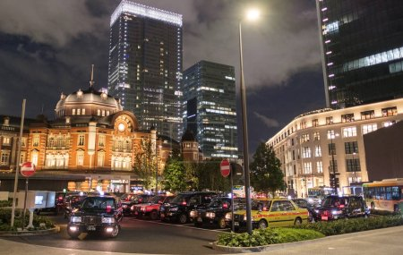 Photo for TOKYO, JAPAN - SEPTEMBER 8TH, 2018. Tokyo Railway Station plaza building illuminated at dusk - Royalty Free Image