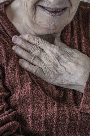 Photo for Closeup wrinkled hand of a senior woman - Royalty Free Image
