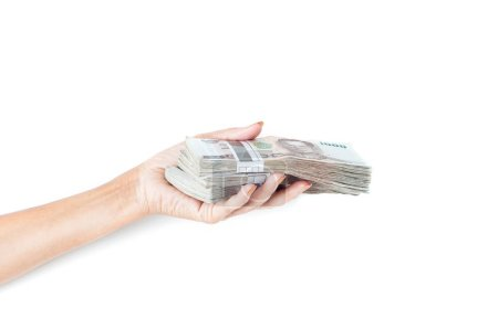 female hand holding money stacks on white background