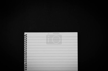 Photo for Empty notebook on black background - Royalty Free Image