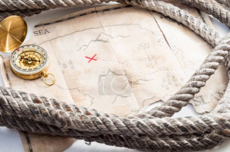 Compass and map of island with treasure sign