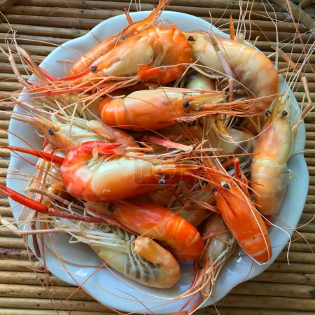 close up of boiled shrimps on white plate