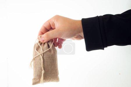 male hand holding sack isolated on white background
