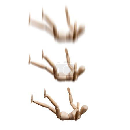 Photo for Falling wooden mannequins on white background - Royalty Free Image