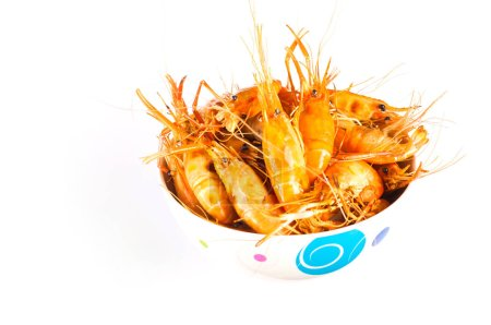 boiled shrimps in dish on white background