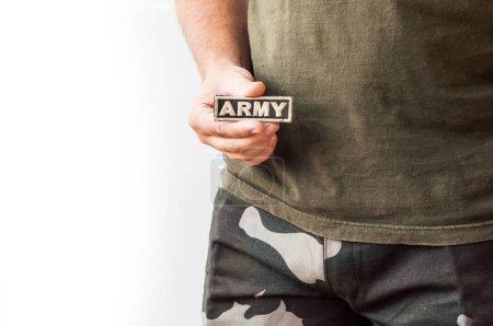 Man holding patch with word army