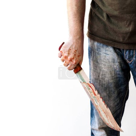 close up of male hand holding bloody knife