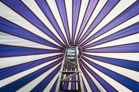 low angle view of circus cupola with metal stair as background