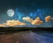 night road background with moon and stars