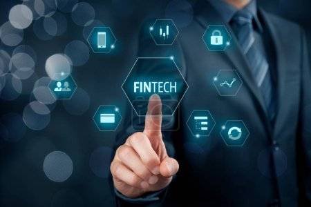 Business person clicking on fintech text and financial icons