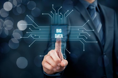 Big data analysis concept. Businessman or IT specialist with abstract symbol of a chip with text big data.