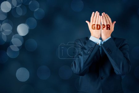 GDPR and personal information protection concept. Businessman, customer or internet user protect his face with hands with text GDPR.