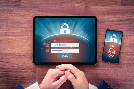 Two-factor authentication (2FA) and face identification security concept. User with digital tablet and smart phone and two-factor authentication security process, flatlay design.